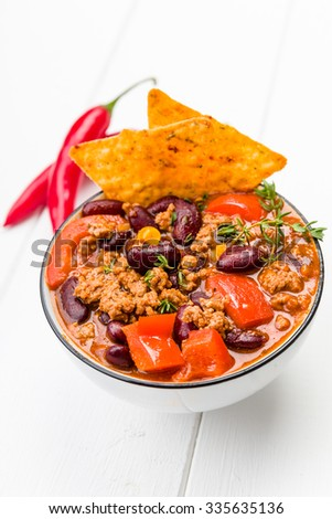 Fresh chili con carne with tortilla chips - stock photo