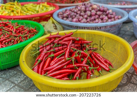 Fresh chilli in the basket. - stock photo