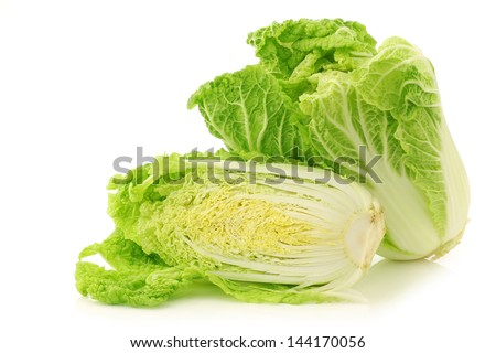 fresh chinese cabbage and a cut one on a white background - stock photo