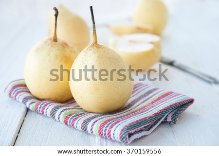 fresh Chinese pears on a wooden table - stock photo