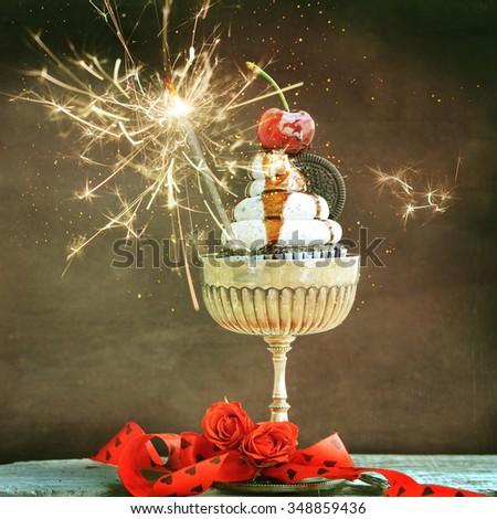 Fresh chocolate cupcake with cherry - stock photo