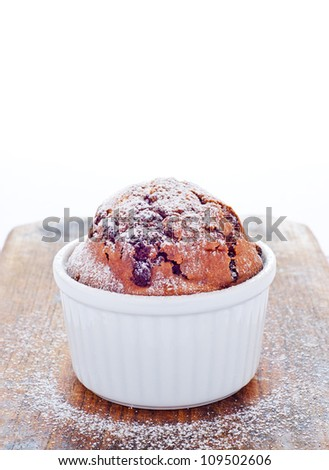 Fresh chocolate muffin baked in ramekin