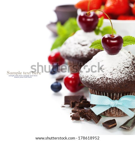 fresh chocolate muffins with cherry. With easy removable sample text - stock photo