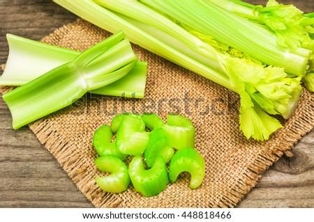 fresh chopped celery on burlap napkin - stock photo