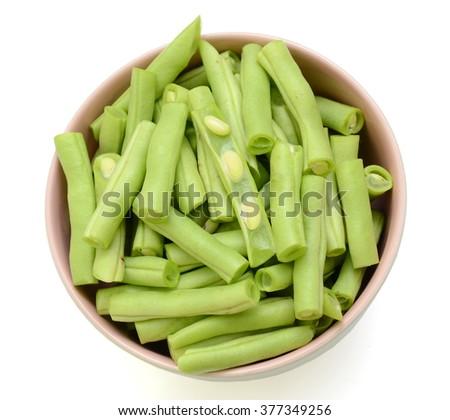 fresh chopped green beans (Phaseolus vulgaris) isolated on white background - stock photo