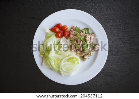 fresh chopped tuna salad with spinach - stock photo