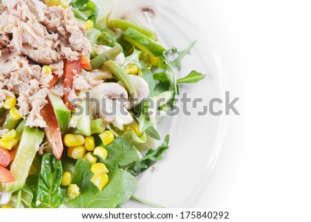 fresh chopped tuna salad with spinach on  white plate