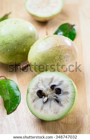 fresh Chrysophyllum cainito  fruits on wood background