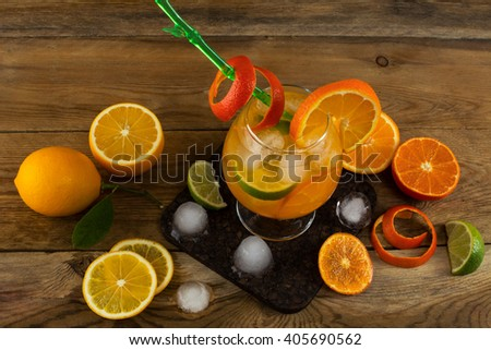 Fresh citrus drink on wooden table. Fruit lemonade. Summer drink. Citrus lemonade. Fruit cocktail. Fruit drink - stock photo