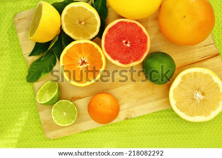 Fresh citrus fruit on a wooden tray  - stock photo