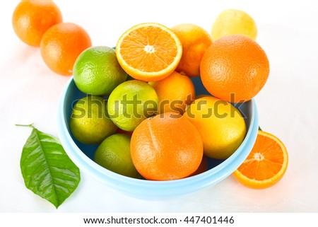 Fresh citrus fruits in a blue bowl