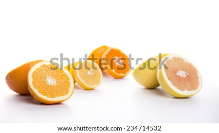 Fresh citrus fruits sliced on a white background.  - stock photo