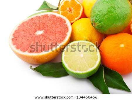 Fresh citrus fruits whole and half with green leaves, food ingredient photo