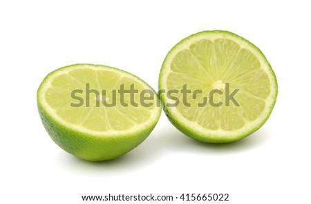fresh Citrus lime fruit with half isolated on white background - stock photo