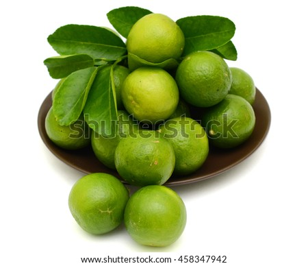 Fresh Citrus lime fruits in bowl isolated on white background