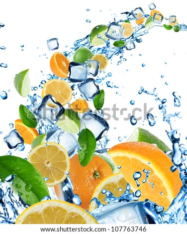 Fresh citruses in water splash with ice cubes - stock photo