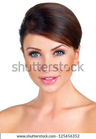 Fresh clean portrait of a beautiful woman with bare shoulders and her hair tied neatly back smiling charmingly at the camera isolated on white - stock photo