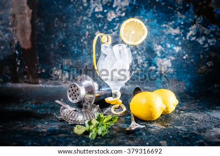 fresh cocktail glass ready for beverage. Barman preparing cocktail at bar, pub or restaurant  - stock photo