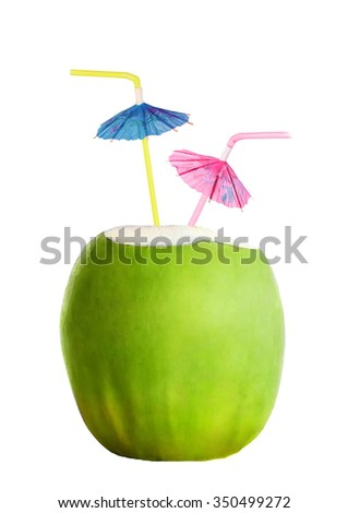Fresh cocktail in green coconut with two colorful umbrellas isolated on white background - stock photo