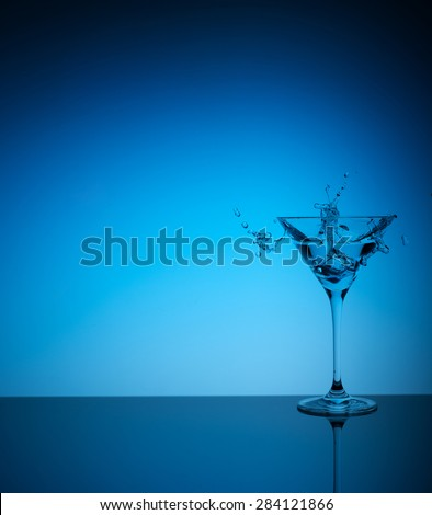 fresh cocktail on the blue background - stock photo