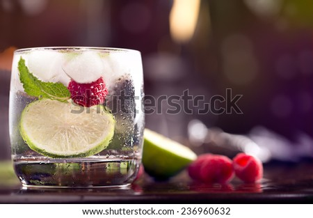 Fresh cocktail with mint and raspberry on the brown table - stock photo