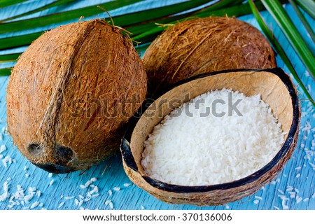 Fresh coconut and coconut chips. Preparation of desiccated coconut at home, the use and application of coconut. Selective focus - stock photo
