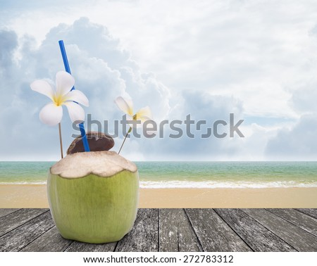 Fresh coconut drink with nice beach background