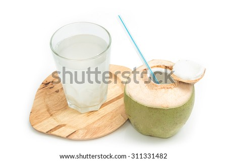 Fresh coconut drink with young coconut on white background - stock photo