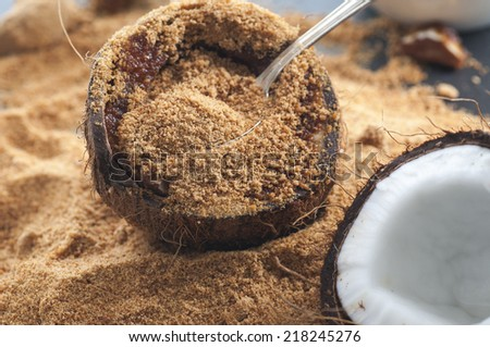 Fresh coconut filled with organic coconut sugar. - stock photo