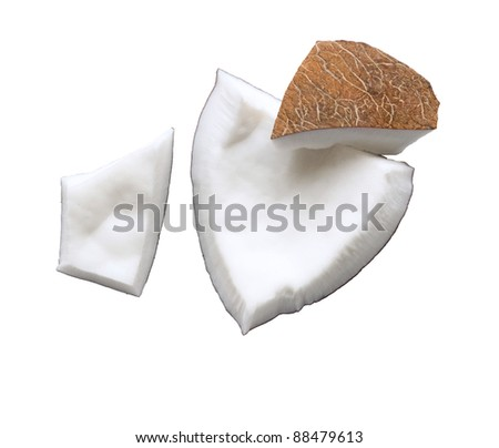 Fresh coconut flesh pieces broken isolated on white background - stock photo