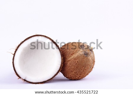 fresh coconut half clipping path for coconut milk and brown coconut shell  on white background fruit food isolated  - stock photo
