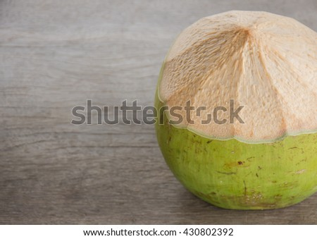 fresh coconut  on old wood  background. - stock photo