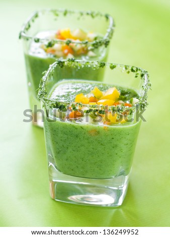 Fresh cold soup (gazpacho)in glass, selective focus - stock photo