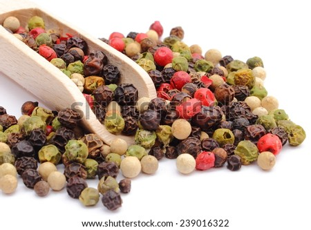 Fresh colored pepper on wooden spoon heap of colored pepper. Isolated on white background - stock photo