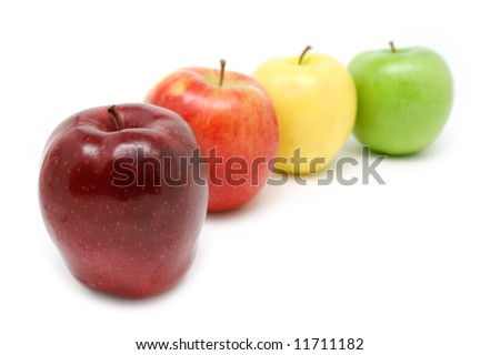 Fresh colorful apples: Red Delicious, Jonagold, Golden Delicious and Granny Smith Green Apple - stock photo
