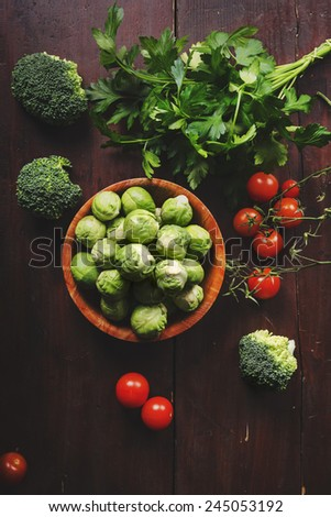 Fresh colorful vegetable on wooden table. Retro style. - stock photo