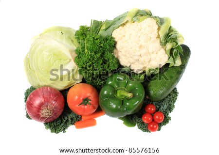 Fresh colorful vegetables like cabbage, tomatoes, onion and kale on a white background