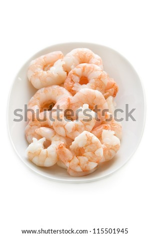 fresh cooked king prawns in a dish isolated on a white background
