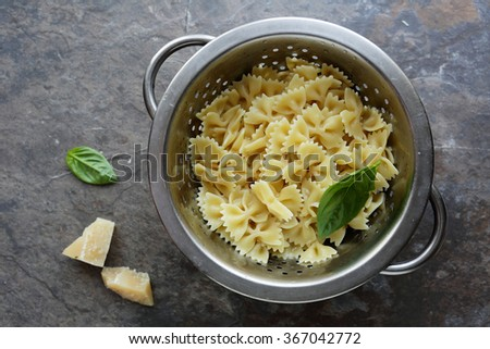 fresh cooked pasta in colander, cooking food - stock photo