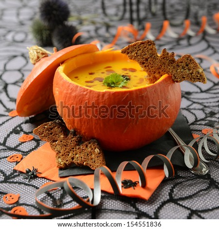 Fresh cooked pumpkin soup on Halloween - stock photo