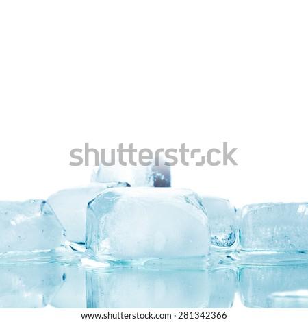 Fresh cool ice cubes macro close up isolated on white - stock photo