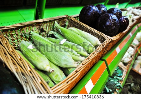 Fresh corn cobs in the store - stock photo