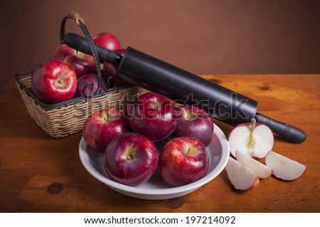 Fresh Cortland apples with a pie plate and rolling pin ready to bake a pie. - stock photo
