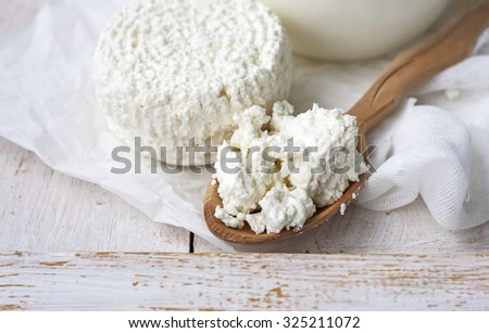 Fresh cottage cheese,  rustic wood background. Selective focus.