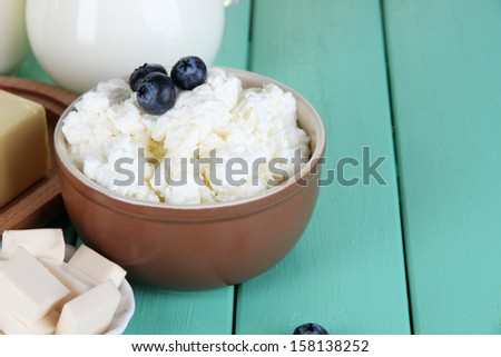 Fresh cottage cheese with blueberry on wooden table close-up