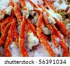 Fresh crab legs at a seafood market. - stock photo