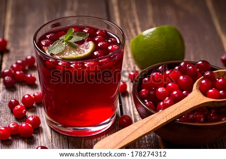 Fresh cranberry drink on wooden background  - stock photo