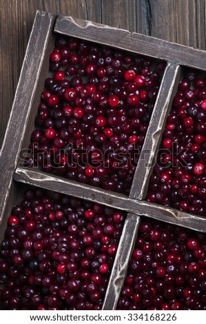 Fresh cranberry on the wooden table, selective focus - stock photo