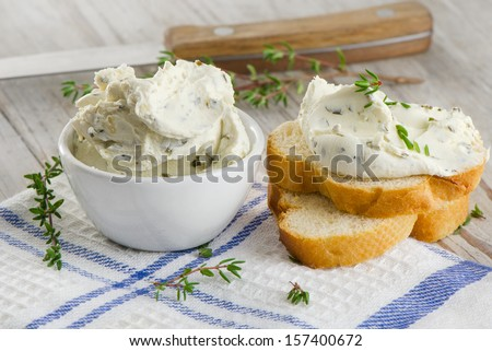 fresh cream cheese with herbs. selective focus - stock photo
