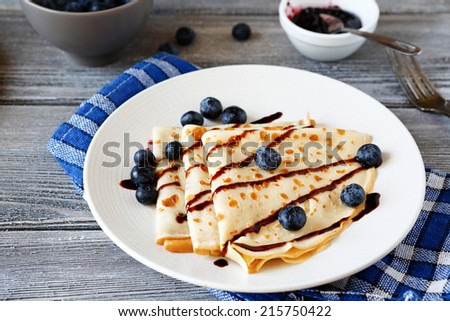 Fresh crepes on a plate, food close up - stock photo